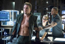 """Arrow -- """"Three Ghosts"""" -- Image AR209b_0246b -- Pictured (L-R): Stephen Amell as The Arrow, Emily Bett Rickards as Felicity Smoak, and David Ramsey as John Diggle -- Photo: Diyah Pera/The CW -- © 2013 The CW Network, LLC. All Rights Reserved"""